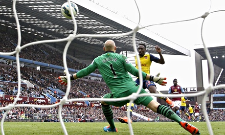 Arsenal's Danny Welbeck scores a goal during the Premier League against Aston Villa