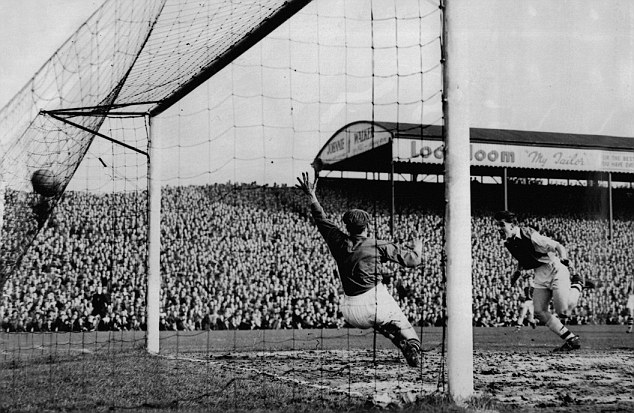 Football F.A. Cup 6th Round 1957: Arsenal V David Herd heads Ars